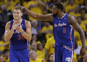 Photo - Los Angeles Clippers' Blake Griffin (32) celebrates with teammate DeAndre Jordan (6) after Griffin drew a fragrant foul during the second half in Game 3 of an opening-round NBA basketball playoff series against the Golden State Warriors on Thursday, April 24, 2014, in Oakland, Calif. Los Angeles won 98-96. (AP Photo/Marcio Jose Sanchez)