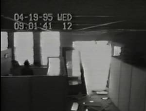 Photo - A Southwestern Bell security camera shows damage to an entrance of the communication company's building after the explosion. The time on the recording is slightly behind the established time of the bombing.