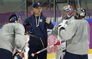 Photo - USA head coach Dan Bylsma, center, talks to his three goalies during a training session at the Bolshoy Ice Dome at the the 2014 Winter Olympics, Tuesday, Feb. 11, 2014, in Sochi, Russia. (AP Photo/Julio Cortez)