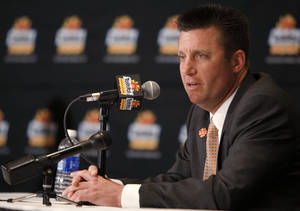 photo - Oklahoma State coach Mike Gundy speaks during a press conference in Paradise Valley, Ariz. Sunday, Jan. 1, 2012. Oklahoma State will play Stanford in the Fiesta Bowl on Monday, January 2, 2012. Photo by Bryan Terry, The Oklahoman