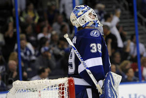 Photo - Tampa Bay Lightning goalie Anders Lindback, of Sweden, reacts after allowing a goal by Montreal Canadiens center David Desharnais during the shootout of an NHL hockey game Tuesday, Feb. 12, 2013, in Tampa, Fla. (AP Photo/Brian Blanco)
