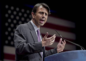 Photo - FILE - In this Feb. 11, 2012 file photo, Republican Gov. Bobby Jindal of Louisiana addresses activists from America's political right at the Conservative Political Action Conference (CPAC) in Washington. Jindal planned to file a lawsuit Wednesday Aug. 27, 2014 against the Obama administration, accusing it of illegally manipulating federal grant money and regulations to force states to adopt the Common Core education standards. (AP Photo/J. Scott Applewhite, File)
