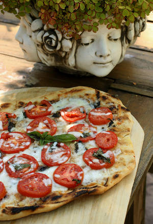 Photo - Baking pizza is not just for the oven, but dough can be baked on an outdoor grill. (Karen Schiely/Akron Beacon Journal/MCT)