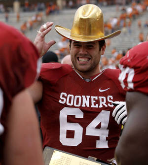 Photo - CELEBRATION: OU's Gabe Ikard (64) celebrates after the Red River Rivalry college football game between the University of Oklahoma (OU) and the University of Texas (UT) at the Cotton Bowl in Dallas, Saturday, Oct. 13, 2012. Oklahoma won 63-21. Photo by Bryan Terry, The Oklahoman