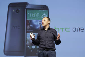Photo - Peter Chou, CEO of HTC, introduces the new HTC One M8, Tuesday, March 25, 2014 in New York. (AP Photo/Mark Lennihan)