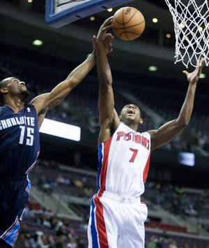 photo -   Detroit Pistons guard Brandon Knight (7) is fouled by Charlotte Bobcats guard Kemba Walker (15) while reaching for a rebound during the first half of an NBA preseason basketball game Saturday, Oct. 20, 2012, in Auburn Hills, Mich. (AP Photo/Duane Burleson)
