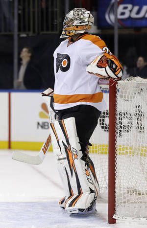 Photo - Philadelphia Flyers goalie Ray Emery reacts after being scored on by New York Rangers' Chris Kreider during the second period of the NHL hockey game, Sunday, Jan. 12, 2014, in New York. (AP Photo/Seth Wenig)
