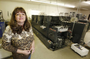 Photo - Sandra Dickinson is the owner of B&S Quality Printing in Oklahoma City. Photo By Steve Gooch, The Oklahoman