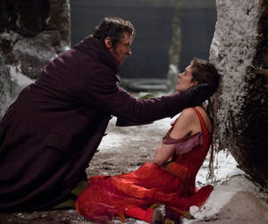 "photo - This film image released by Universal Pictures shows Hugh Jackman as Jean Valjean, left, and Anne Hathaway as Fantine in a scene from ""Les Miserables.""  The film was nominated for a Golden Globe for best musical or comedy on Thursday, Dec. 13, 2012. The 70th annual Golden Globe Awards will be held on Jan. 13. (AP Photo/Universal Pictures)"