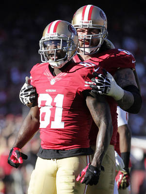 Photo - San Francisco 49ers wide receiver Anquan Boldin (81) celebrates with guard Adam Snyder after a reception during the second quarter of an NFL football game against the St. Louis Rams in San Francisco, Sunday, Dec. 1, 2013. The 49ers won 23-13. (AP Photo/Tony Avelar)