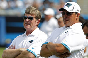 photo -   Carolina Panthers general manager Marty Hurney, left, stands next to coach Ron Rivera during the NFL football team's Fan Fest in Charlotte, N.C., Saturday, Aug. 4, 2012. (AP Photo/Bob Leverone)