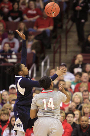 Photo - Penn State's Alex Bentley, left, shoots over Ohio State's Ameryst Alston during the first half of an NCAA college basketball game on Sunday, Jan. 27, 2013, in Columbus, Ohio. (AP Photo/Jay LaPrete)