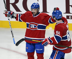photo - Montreal Canadiens center Tomas Plekanec (14) celebrates with defenseman Raphael Diaz (61) after scoring against the Winnipeg Jets during the third period of an NHL hockey game Tuesday, Jan. 29, 2013, in Montreal. (AP Photo/The Canadian Press, Ryan Remiorz)