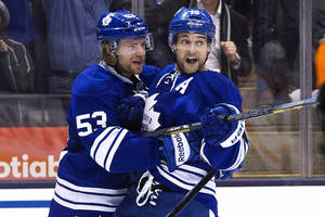 photo - Toronto Maple Leafs' Clarke MacArthur, right, celebrates his goal with Michael Kostka against the Philadelphia Flyers during the second period of their NHL hockey game, Monday, Feb. 11, 2013, in Toronto. (AP Photo/The Canadian Press, Chris Young)