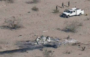 Photo -   This video framegrab image provided Thursday Feb. 23, 2012 by KPNX-12 News shows an aerial view of a crash site where two U.S. Marine helicopters collided Wednesday over a training site in the desert near Yuma, Ariz. The crash killed seven Marines, in one of the deadliest military training accidents in years.(AP Photo/ KPNX-12 News) MANDATORY CREDIT