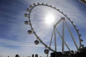 Photo - The Las Vegas High Roller at The LINQ begins to operate on Monday, March 31, 2014, in Las Vegas. The 550-foot-tall attraction, which opened to the public on Monday, is the highest observation wheel in the world and features 28 cabins that can accommodate up to 40 people each. (AP Photo/David Becker)