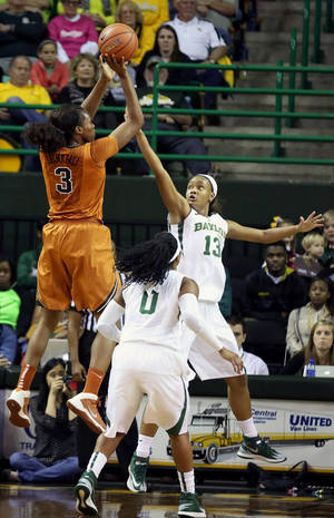 Photo - Texas forward Nneka Enemkpali (3) shoots over Baylor guard Odyssey Sims (0) and Nina Davis (13) in the first half of an NCAA college basketball game, Saturday, Feb. 1, 2014, in Waco, Texas. (AP Photo/The Waco Tribune-Herald, Rod Aydelotte)