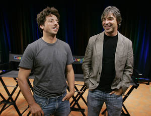 Photo - FILE - In this Sept. 2, 2008 file photo, Google co-founders Sergey Brin, left, and Larry Page talk during a new conference at Google Inc. headquarters in Mountain View, Calif. Google has settled a shareholder lawsuit to clear the way for a long-delayed split of the Internet search leader's stock. The agreement announced Monday, June 17, 2013, resolves allegations that Google co-founders Page and Brin engineered the stock split in a way that unfairly benefits them and shortchanges the rest of the company's shareholders. (AP Photo/Paul Sakuma, File)