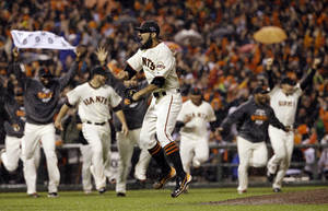Photo -   San Francisco Giants relief pitcher Sergio Romo reacts after the final out in Game 7 of baseball's National League championship series against the St. Louis Cardinals Monday, Oct. 22, 2012, in San Francisco. The Giants won 9-0 to win the series. (AP Photo/David J. Phillip)