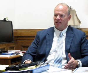 Photo -   Wyoming Gov. Matt Mead sits in his office at the State Capitol in Cheyenne, Wyo. on Friday, June 15, 2012. Mead recently returned from a meeting on clean coal technology in China. (AP Photo/Ben Neary)