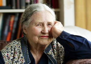 "Photo - FILE - In this April 17, 2006 file photo, Writer Doris Lessing, 86, sits in her home in north London. Doris Lessing, the free-thinking, world-traveling, often-polarizing writer of ""The Golden Notebook"" and dozens of other novels that reflected her own improbable journey across the former British empire, has died, early Sunday, Nov. 17, 2013.  She was 94. The author of more than 50 works of fiction, nonfiction and poetry, Lessing explored topics ranging from colonial Africa to dystopian Britain, from the mystery of being female to the unknown worlds of science fiction.  (AP Photo/Martin Cleaver, File)"