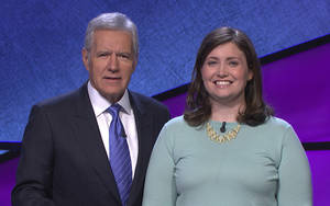 "Photo - In this January 2014 photo provided by Jeopardy Productions, Inc., shows Alex Trebek, host of the TV show ""Jeopardy!,"" poses with contestant Julia Collins, 31, of Kenilworth, Ill., during the taping of her shows on stage at JEOPARDY!, Sony Pictures Studios, Culver City, Calif. On a show that aired Tuesday, May 27, 2014, Collins won her 17th straight game on Jeopardy! and has won more games than all but two other contestants in the history of the show. (AP Photo/Courtesy of Jeopardy Productions, Inc.)"