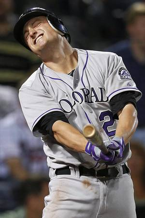 Photo -   Colorado Rockies' Jordan Pacheco (22) reacts after striking out with runners on base to end the eighth inning of a baseball game against the Atlanta Braves, Wednesday, Sept. 5, 2012, in Atlanta. (AP Photo/John Bazemore)
