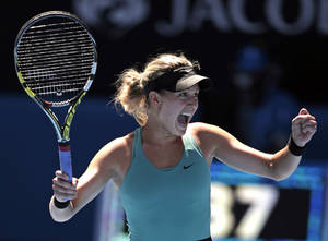 Photo - Eugenie Bouchard of Canada celebrates after defeating Ana Ivanovic of Serbia during their quarterfinal at the Australian Open tennis championship in Melbourne, Australia, Tuesday, Jan. 21, 2014. (AP Photo/Rick Rycroft)