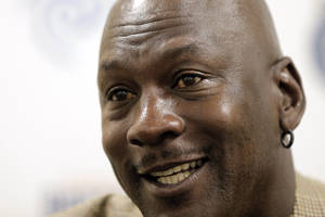 Photo - Charlotte Bobcats owner Michael Jordan smiles as he talks about the progress his NBA basketball team is making during an interview with The Associated Press Friday, Nov. 1, 2013,  in Charlotte, N.C. (AP Photo/Chuck Burton)