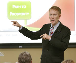 photo - Congressman James Lankford talks with  constituents during his town hall meeting at Francis Tuttle in Oklahoma City, Tuesday, July 3, 2012. Photo By Steve Gooch, The Oklahoman