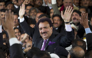 photo -   FILE - In this Thursday, Jan. 19, 2012 file photo, Pakistani interior minister Rehman Malik waves as he leaves the Supreme court in Islamabad, Pakistan. The court in recent months has targeted Pakistan's interior minister, Rehman Malik, on the citizenship issue. Malik resigned his Senate seat, renounced his British citizenship and won his seat back in a special election, but the court is still looking at prosecuting him for allegedly not revealing his full status when he first held the seat. (AP Photo/B.K. Bangash, File)