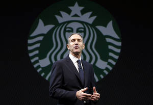 Photo - FILE - In this  Wednesday, March 20, 2013, file photo, Starbucks CEO Howard Schultz speaks at the company's annual shareholders meeting,in Seattle, Wash. Starbucks Corp. reports quarterly financial results after the market closes on Thursday, April 25, 2013. (AP Photo/Ted S. Warren)