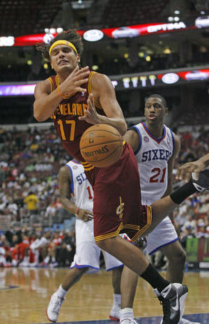 Photo -   Cleveland Cavaliers' Anderson Varejao (17) loses control of the ball after being fouled by the Philadelphia 76ers in the first half of an NBA preseason basketball game on Wednesday Oct. 17, 2012, in Philadelphia. (AP Photo H. Rumph Jr)