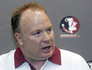 Photo - FILE - In this Aug. 12, 2012, file photo, Florida State defensive coordinator Mark Stoops is interviewed during the Seminoles' football media day in Tallahassee, Fla. Kentucky has hired Florida State defensive coordinator Mark Stoops as its new football coach. The university announced Tuesday, Nov. 27, 2012 that Stoops will replace Joker Phillips, who was fired on Nov. 4.  (AP Photo/Phil Sears, File)