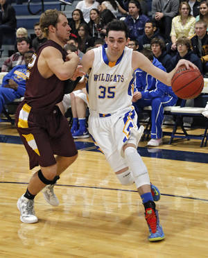 Photo - Piedmont's Grant Gipson (35) drives past Clinton's Bowman Vowell (42) during a basketball tournament at the Kingfisher High School gym on Thursday, Jan. 24, 2013, in Kingfisher, Okla.  Photo by Chris Landsberger, The Oklahoman