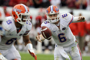 Photo -   Florida quarterback Jeff Driskel (6) bobbles the ball during the first half of an NCAA college football game against Georgia, Saturday, Oct. 27, 2012 in Jacksonville, Fla. (AP Photo/Stephen Morton)