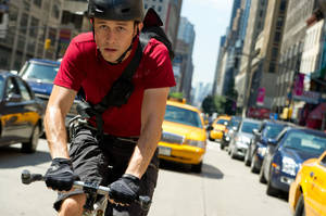 "Joseph Gordon-Levitt as a New York bicycle messenger pursued by a crooked cop in ""Premium Rush."" COLUMBIA PICTURES PHOTO <strong></strong>"