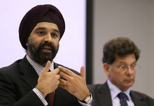 Photo -   Dr. Harpal Kumar, Chief Executive of Cancer Research UK, left, speaks at a news conference about breast cancer screening in London, Monday, Oct. 29, 2012. Breast cancer screening for women over 50 saves lives, an expert panel was commissioned by Cancer Research U.K. has concluded, confirming findings in U.S. and other studies. (AP Photo/Kirsty Wigglesworth)