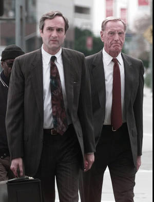 Photo - Former savings and loan heavyweight Charles Keating, Jr., right, arrives at Federal court with his attorney Stephen Neal for a hearing Thursday, Feb. 5, 1998 in Los Angeles. A federal appeals court reinstated Keating's state securities fraud convictions for swindling thousands of dollars from mostly elderly members of Lincoln Savings and Loan. (AP Photo/Susan Sterner)