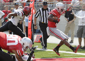 Photo - Ohio State running back Donte Wilson scores a touchdown past San Diego State defensive back Marcus Andrews during the first quarter of an NCAA college football game Saturday, Sept. 7, 2013, in Columbus, Ohio. (AP Photo/Jay LaPrete)