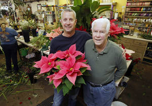 photo - Kent Whitnah and his father Jack Whitnah pose for a photo at Capitol Hill Florist at 5809 S Western, By Paul Hellstern, The Oklahoman <strong>PAUL HELLSTERN</strong>