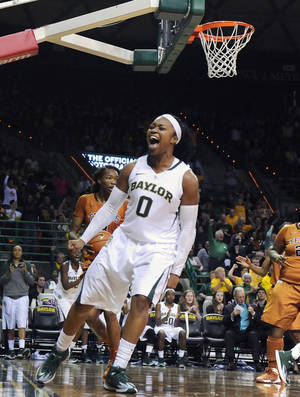 Photo - Baylor guard Odyssey Sims (0) reacts after scoring in the second half of an NCAA college basketball game against Texas, Saturday, Feb. 1, 2014, in Waco, Texas. (AP Photo/The Waco Tribune-Herald, Rod Aydelotte)