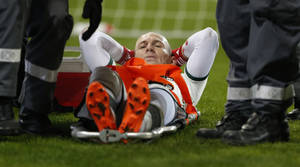 Photo - Bayern's Arjen Robben of the Netherlands is taken off the field on a stretcher during the German soccer cup third round match between FC Augsburg and FC Bayern Munich in Augsburg, southern Germany, Wednesday, Dec. 4, 2013. (AP Photo/Matthias Schrader)