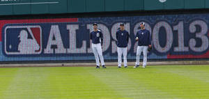Photo - Detroit Tigers pitchers Justin Verlander, left, Drew Smyly, center and Max Scherzer watch batting practice before Game 3 of an American League baseball division series against the Oakland Athletics in Detroit, Monday, Oct. 7, 2013. (AP Photo/Paul Sancya)