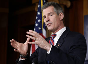 Photo - FILE - In this Nov. 13, 2012 file photo, then-Massachusetts Sen. Scott Brown speaks on Capitol Hill in Washington. Brown has begun seeking campaign staff while courting New Hampshire's political elite. The moves represent what local Republicans consider Brown's first serious steps toward launching a Senate campaign against Democratic Sen. Jeanne Shaheen. The stakes are high for the GOP's push for the Senate majority this fall and Brown's own political ambitions.  (AP Photo/Alex Brandon, File)