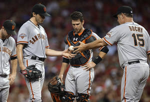 Photo - San Francisco Giants manager Bruce Bochy (15) takes out starting pitcher Barry Zito in the fifth inning of a baseball game against the Cincinnati Reds, Wednesday, July 3, 2013, in Cincinnati. Catcher Buster Posey is at center. (AP Photo/Al Behrman)