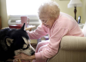 Photo - Left:  Clarice Bruce visits Jake at Tuscany Village.  Photos by Sarah Phipps,  The Oklahoman <strong>SARAH PHIPPS -   </strong>