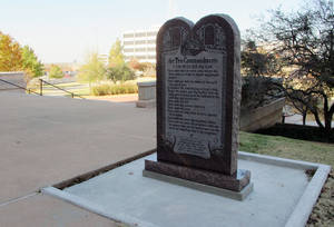 "Photo - A Ten Commandments monument erected outside the Oklahoma state Capitol is shown on Friday, Nov. 16, 2012. After the 6-foot-tall monument was put in place, the Oklahoma lawmaker who paid for it acknowledged the misspelling of the words Sabbath as ""Sabbeth"" and maidservant as ""maidseruant."" (AP Photo/Sean Murphy) ORG XMIT: OKSM101"