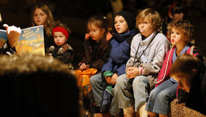 Photo - Children listen to a story at Storybook Forest at Arcadia Lake. Wednesday is the last night.  PHOTOs BY NATE BILLINGS, THE OKLAHOMAN