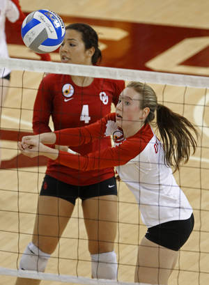 photo - Sooner Eden Williams (6) returns a ball as Maria Fernanda (4) calls to players during the first-round NCAA  Volleyball Tournament match between Wichita State and Oklahoma at McCasland Field House in Norman on Friday, December 3, 2010, in Norman, Okla.  Photo by Steve Sisney, The Oklahoman
